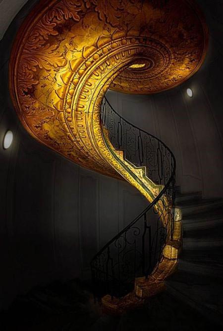 Черный интерьер с золотой винтовой лестницей
