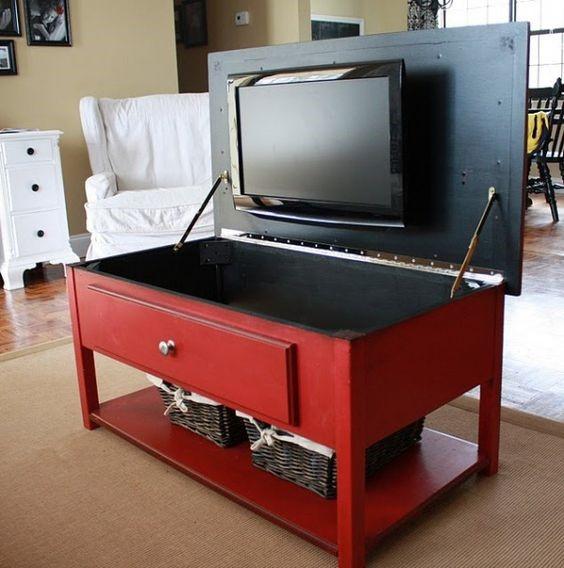 Телевизор, спрятанный под крышкой комода