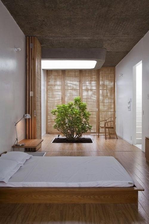 Стильный минималистичный интерьер спальни с японскими нотками